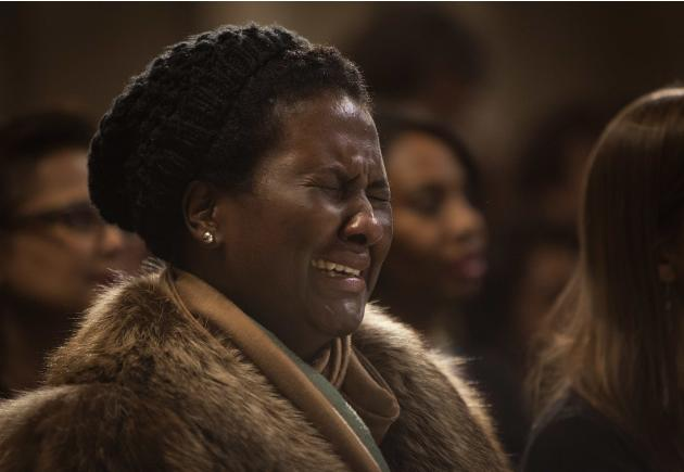 A woman cries during a memorial service for the late Nelson Mandela at the Riverside Church in New York