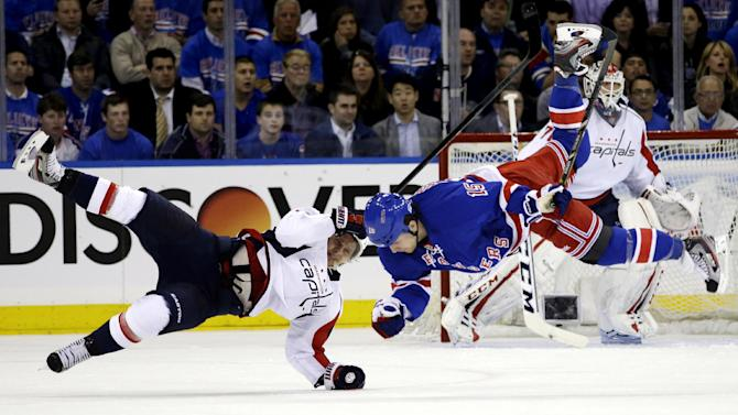 Washington Capitals left wing Martin Erat, of the Czech Republic, and New York Rangers right wing Derek Dorsett (15) are upended after colliding in the first period of Game 3 of their first-round NHL hockey Stanley Cup playoff series in New York, Monday, May 6, 2013. The Rangers won 4-3. (AP Photo/Kathy Willens)