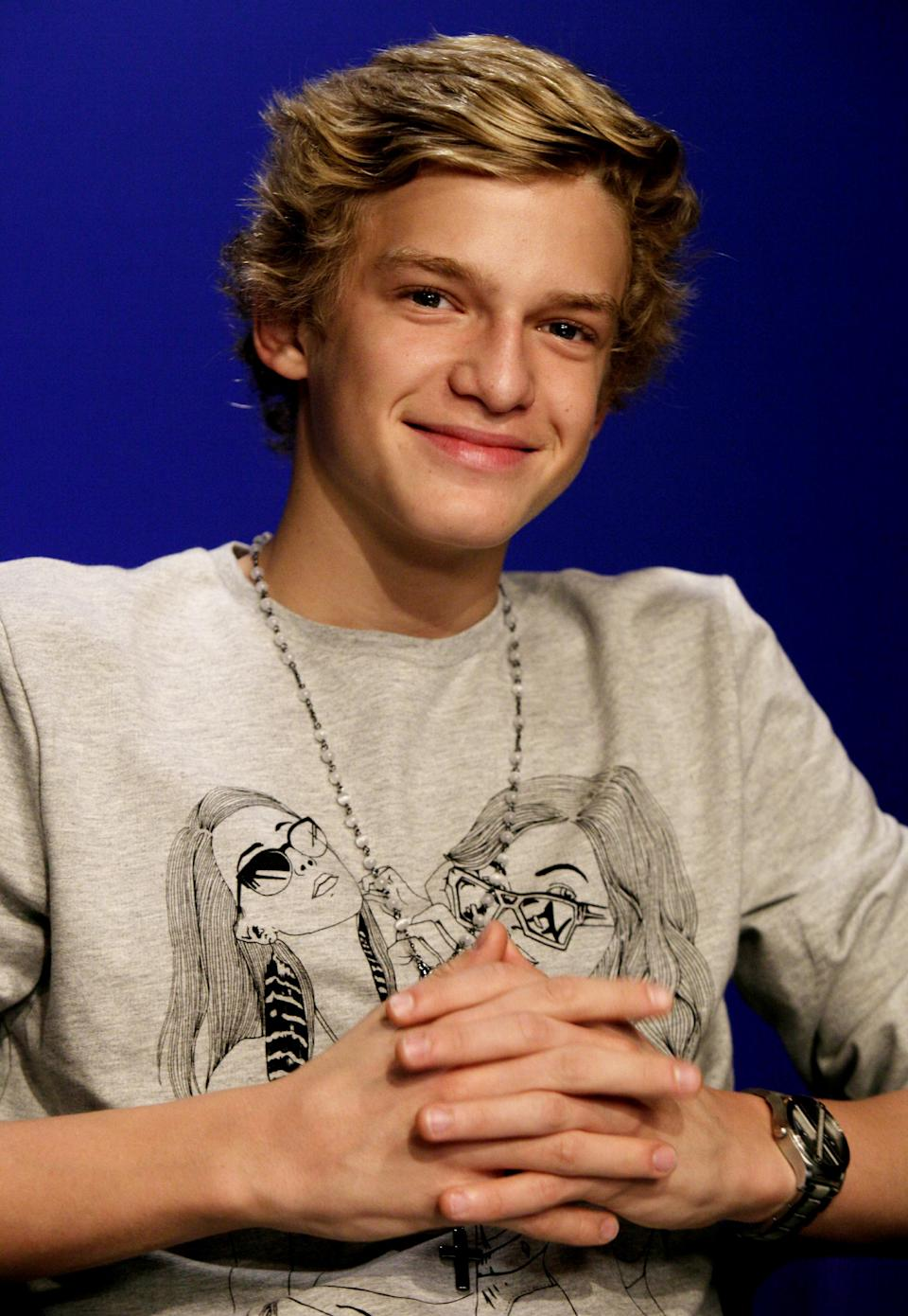 FILE - In this Sept. 28, 2011 file photo, singer Cody Simpson, 14, poses for photos during an interview in New York. Simpson is one of many young singers blazing the charts. (AP Photo/Richard Drew, file)