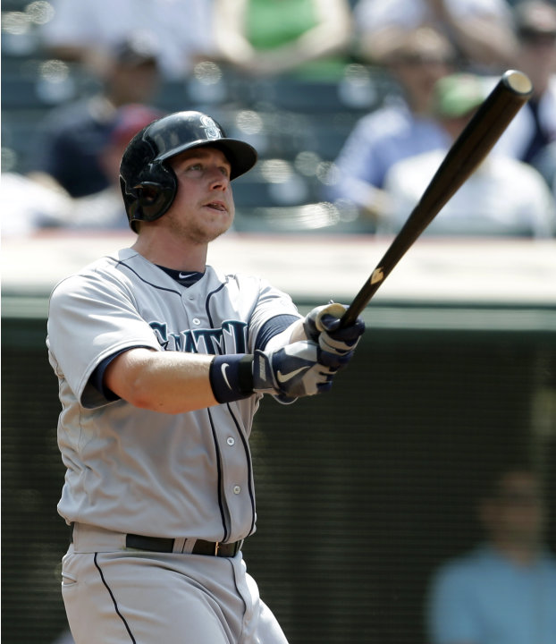 Seattle Mariners' Justin Smoak watches his solo home run off Cleveland Indians relief pitcher Joe Smith in the 10th inning of a baseball game, Monday, May 20, 2013, in Cleveland. (AP Photo/Tony Dejak)