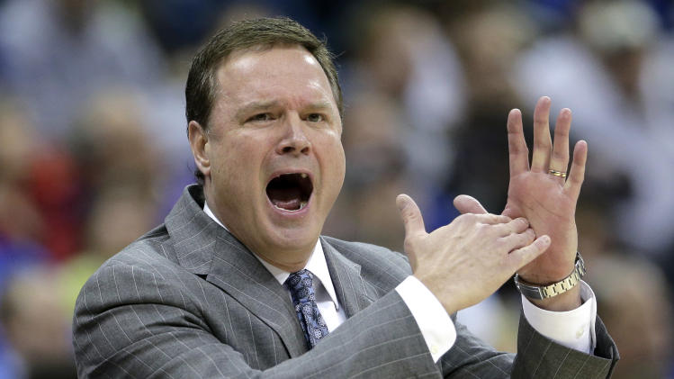 Kansas coach Bill Self gestures for a timeout during the first half of a second-round game against Western Kentucky in the NCAA men's college basketball tournament Friday, March 22, 2013, in Kansas City, Mo. (AP Photo/Charlie Riedel)