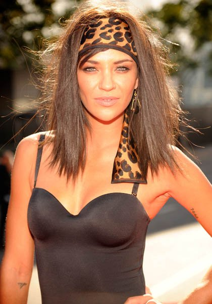 Jessica Szohr added a wild, leopard silk headscarf to her lion-like mane for a decidedly striking, jungle-inspired feel. (Kevin Mazur/WireImage)