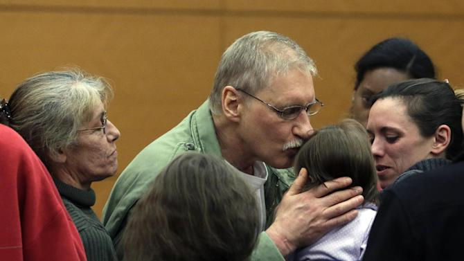 David Ranta kisses a family member after Judge Miriam Cyrulnik freed him, in state Supreme Court in Brooklyn, New York,  Thursday, March 21, 2013. Ranta, 58, who spent more than two decades behind bars was freed by a New York City judge on Thursday after a reinvestigation of his case cast serious doubt on evidence used to convict him in the Feb. 8, 1990 shooting of Rabbi Chaskel Werzberger. (AP Photo/Richard Drew, Pool)