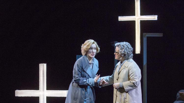 """In this Feb. 22, 2013 photo provided by the New York City Opera, cast members of the the New York City Opera Sara Jakubiak as the Governess, left, and Sharmay Musacchio as Mrs. Grose perform during a dress rehearsal of """"The Turn of the Screw,"""" at the Brooklyn Academy of Music in New York. (AP Photo/New York City Opera, Richard Termine)"""