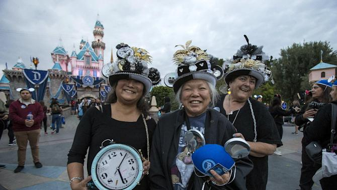 Guests Singer, Thunell and Williams pose during Disneyland's Diamond Celebration in Anaheim