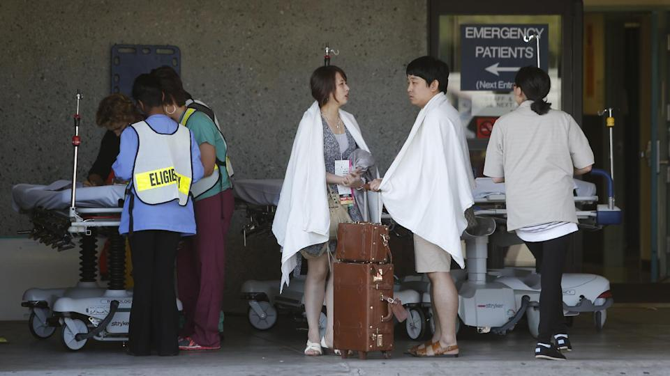 Passengers from Asiana Flight 214 are treated at San Francisco General Hospital after the plane crashed at San Francisco International Airport in San Francisco, Saturday, July 6, 2013. (AP Photo/Bay Area News Group, John Green)