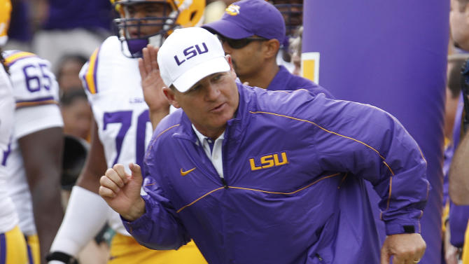 LSU coach Les Miles leads his team onto the field before an NCAA college football game against North Texas in Baton Rouge, La. Saturday, Sept. 1, 2012.  (AP Photo/Bill Haber)
