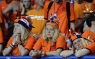 Dutch fans stand dejected after the Euro 2012 soccer championship Group B match between the Netherlands and Denmark in Kharkiv , Ukraine, Saturday, June 9, 2012. The Netherlands lost the match to Denmark 0-1. (AP Photo/Geert Vanden Wijngaert)
