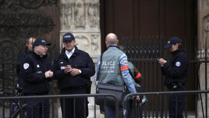 A forensic team arrive at the Notre Dame Cathedral after a man committed suicide, in Paris, Tuesday, May 21, 2013. Notre Dame has been evacuated after a man committed suicide in the 850-year-old monument and tourist attraction. (AP Photo/Thibault Camus)