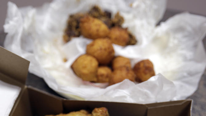 This Wednesday, Feb. 6, 2013 photo shows fried chicken, foreground, and fried chicken livers with hush puppies at a restaurant in Charlotte, N.C. Deep-fried foods may be causing trouble in the Deep South. People whose diets are heavy on them and sugary drinks were more likely to suffer a stroke, according to a new study released Thursday, Feb. 7, 2013. (AP Photo/Chuck Burton)