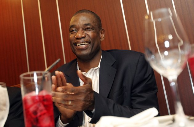 In this Wednesday, June 13, 2012 photo, former NBA star Dikembe Mutombo smiles during his meeting with sports journalists at a restaurant in Tokyo. Mutombo is doing his bit to help basketball continue to grow internationally. Appointed as the NBA's global ambassador in 2009, Mutombo is in Japan to conduct basketball clinics with the Basketball Without Borders program. (AP Photo/Junji Kurokawa)