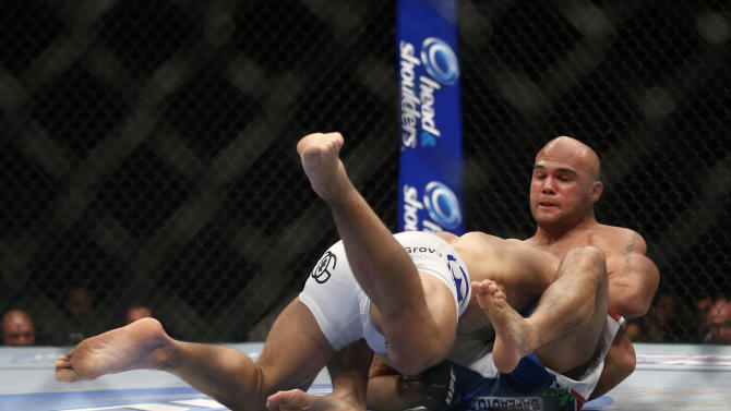 Robbie Lawler, right, chokes Josh Koscheck during their UFC welterweight mixed martial arts match in Anaheim, Calif., Saturday, Feb. 23, 2013. Lawler won by TKO in the first round. (AP Photo/Jae C. Hong)