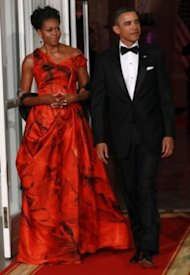 Michelle Obama has been criticized for wearing this dress by non-American designer Alexander McQueen. / Getty Images