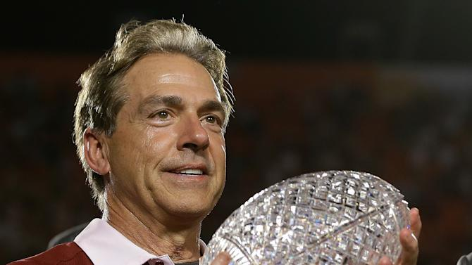 Alabama head coach Nick Saban holds The Coaches Trophy after the BCS National Championship college football game against Notre Dame Monday, Jan. 7, 2013, in Miami. Alabama won 42-14. (AP Photo/David J. Phillip)