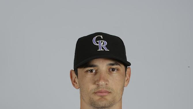 This is a 2015 photo of Jason Gurka of the Colorado Rockies baseball team. This image reflects the Rockies active roster as of March 1, 2015, when this image was taken. (AP Photo/Darron Cummings)