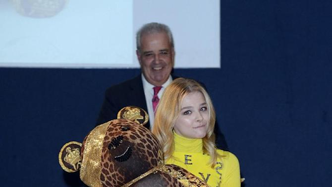 Chloë Grace Moretz seen at the Designer Pudsey 2012 Collection auction in association with BBC's Children in Need at Christie's Auction House on Thursday, Nov. 15, 2012, in London. (Photo by Jon Furniss/Invision for Children in Need/AP Images)