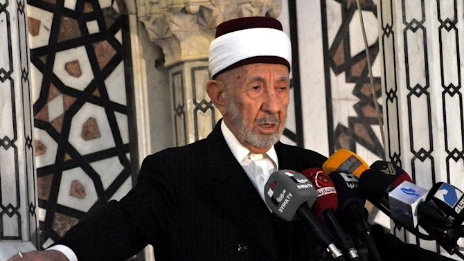 In this undated photo released by the Syrian official news agency SANA, Sheikh Mohammad Said Ramadan al-Buti, an 84-year-old cleric known to all Syrians as a religious scholar, speaks at a press conference. Al-Buti, a top Sunni Muslim preacher and longtime supporter of President Bashar Assad was killed in a suicide bombing in the Eman Mosque, at the Mazraa district, in Damascus, Syria, Thursday, March 21, 2013, state TV reported . (AP Photo/SANA)