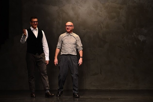 Italian designers Stefano Gabbana (L) and Domenico Dolce appear at women's fashion week in Milan on February 24, 2013