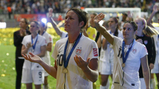 United States' Abby Wambach gestures to the crowd after the US lost the final match between Japan and the United States at the Women's Soccer World Cup in Frankfurt, Germany, Sunday, July 17, 2011. The Japanese women's soccer team won their first World Cup Sunday after defeating USA in a penalty shoot-out.((AP Photo/Michael Probst)