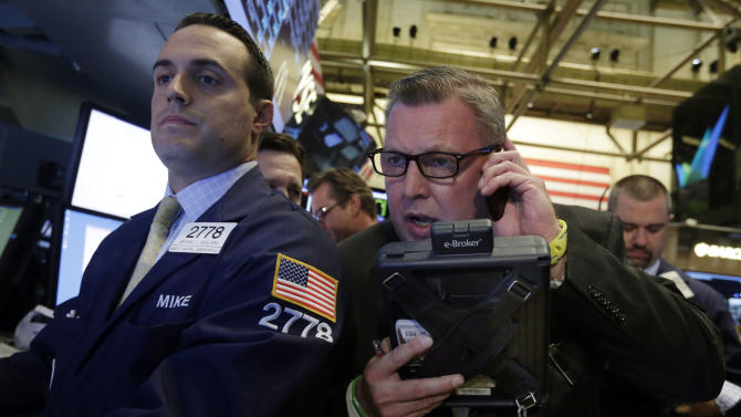 Specialist Michael Gagliano, left, and trader Mathias Roberts, right, work on the floor of the New York Stock Exchange, Thursday, Oct. 10, 2013. Stocks are rising sharply in early trading on Wall Street following hopeful signs that a budget impasse in Washington may break soon. (AP Photo/Richard Drew)