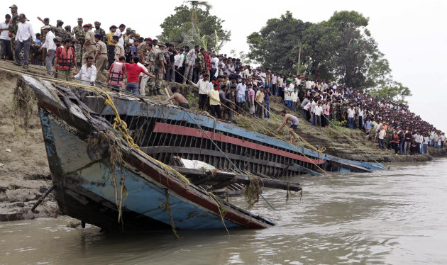 Rescuers pull out the wreckage of a ferry that capsized in the Brahmaputra River at Buraburi village, about 350 kilometers (215 miles) west of the state capital Gauhati, India, Tuesday, May 1, 2012.  