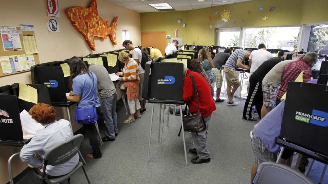 South Floridians mark their ballots during the last day of early voting in Miami Beach