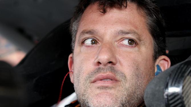 Tony Stewart sits in his car during practice for the NASCAR Sprint Cup Series in Watkins Glen, New York on August 8, 2014
