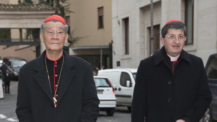 Vietnamese Cardinal Jean-Baptiste Pham Minh Man, left, and cardinal Giuseppe Betori arrive for a meeting, at the Vatican, Thursday, March 7, 2013. The cardinals didn't set a date for the start of the conclave, and the Vatican spokesman, the Rev. Federico Lombardi, said he didn't expect a decision to be taken in Thursday's afternoon session. The last of the 115 voting-age cardinals, Vietnamese Cardinal Jean-Baptiste Pham Minh Man, arrived later Thursday and the date can't be set until he does. (AP Photo/Andrew Medichini)