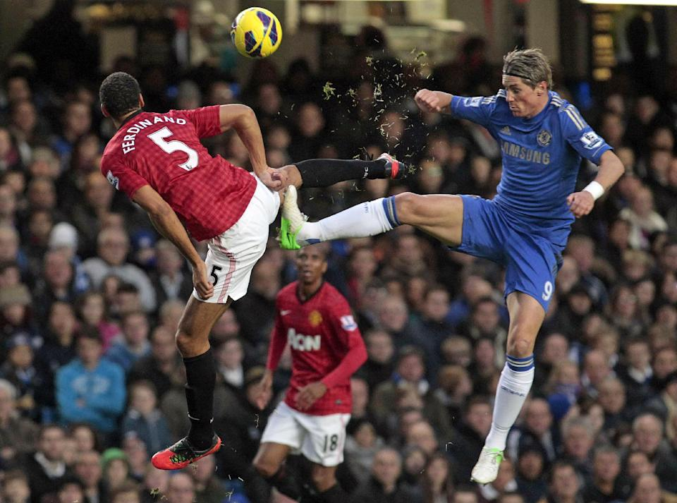 Chelsea's Fernando Torres, right, competes with Manchester United's Rio Ferdinand, during their English Premier League soccer match at Stamford Bridge, London, Sunday, Oct. 28, 2012. (AP Photo/Sang Tan)