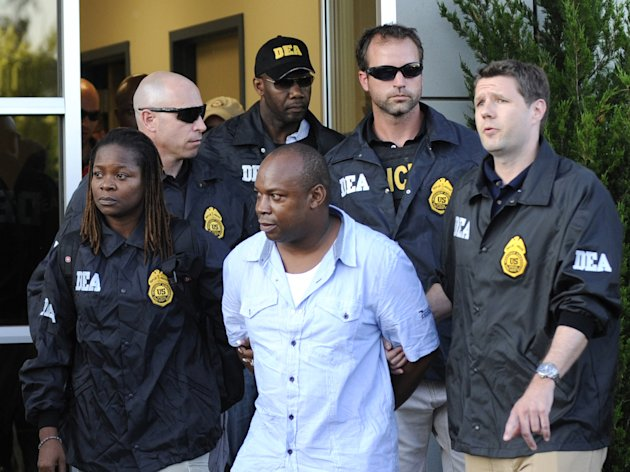 "FILE - In this June 24, 2010 file photo, DEA agents bring Jamaican gang leader Christopher ""Dudus"" Coke From Westchester County Airport to a waiting vehicle in White Plains, New York. Coke, who pleaded guilty to U.S. charges of drug and gun trafficking, has been sentenced to 23 years in prison Friday, June 8, 2012 in federal court in Manhattan. (AP Photo/ Louis Lanzano, File)"