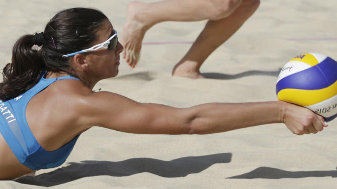 Italy's Marta Menegatti dives for the ball during a beach volleyball match against Russia at the 2012 Summer Olympics, Sunday, July 29, 2012, in London. (AP Photo/Dave Martin)