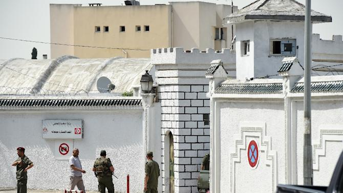 Tunisian soldiers stand guard outside the Bouchoucha army barracks in Tunis on May 25, 2015
