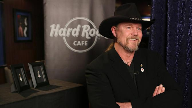 IMAGE DISTRIBUTED FOR HARD ROCK INTERNATIONAL - American Red Cross spokesperson and country star Trace Adkins launches a partnership between Hard Rock and the American Red Cross in support of American Red Cross Month, Wednesday, Feb. 27, 2013, in Hollywood, Calif.  Adkins revealed Hard Rock's limited-edition Red Cross Pin, with a portion of the retail price benefiting the American Red Cross. (Photo by Rene Macura/Invision for Hard Rock International/AP Images)