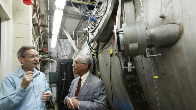 NASA Administrator Charles Bolden, right, talks with electric propulsion engineer John Brophy during a visit to Nasa's Jet Propulsion Laboratory in Pasadena, Calif., Thursday, May 23, 2013. They are standing next to an ion engine, which NASA engineers plan to use for an asteroid capture mission later this decade. (AP Photo/Nick Ut)