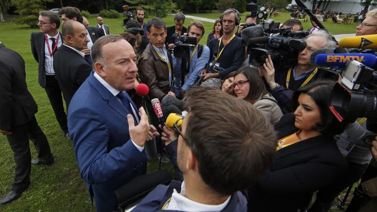 French employer's body MEDEF union leader Pierre Gattaz speaks to journalists during the MEDEF summer forum on the campus of the HEC School of Management in Jouy-en-Josas