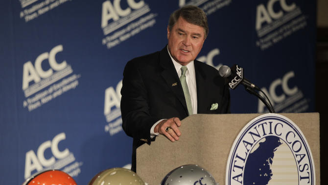 Atlantic Coast Conference commissioner John Swofford speaks to the media during the conference's college football kickoff news conference in Greensboro, N.C., Sunday, July 22, 2012. (AP Photo/Chuck Burton)