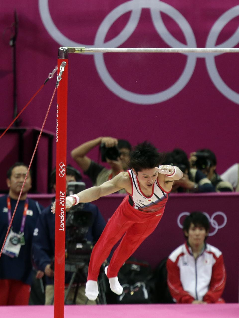 Japanese gymnast Kohei Uchimura falls off the horizontal bar during the Artistic Gymnastic men's qualification at the 2012 Summer Olympics, Saturday, July 28, 2012, in London. (AP Photo/Julie Jacobson)
