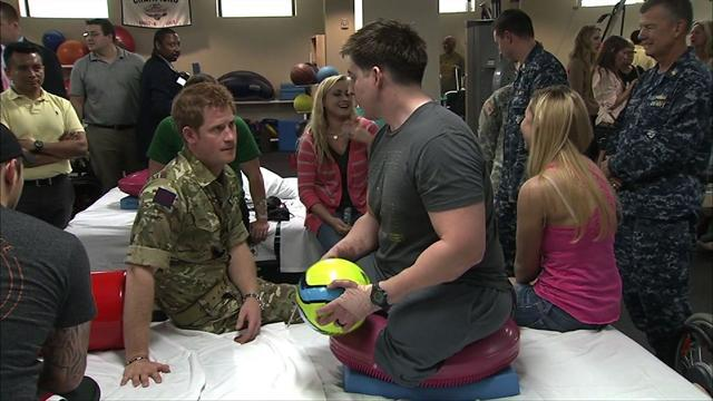 Prince Harry visits wounded service members at Walter Reed