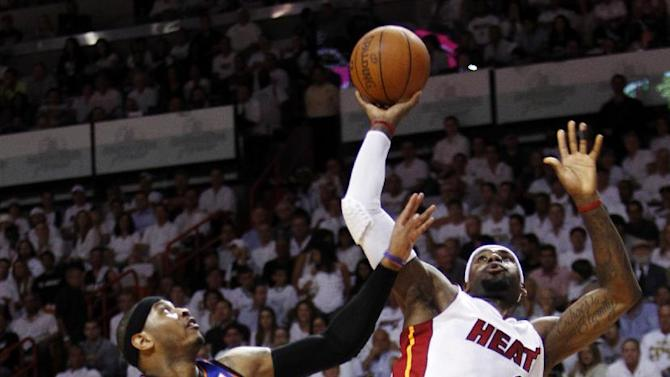 Miami Heat forward LeBron James (6) goes up for a shot against New York Knicks forward Carmelo Anthony (7) during the first half of an NBA basketball game in the first round of the Eastern Conference playoffs, Wednesday, May 9, 2012, in Miami. (AP Photo/Wilfredo Lee)