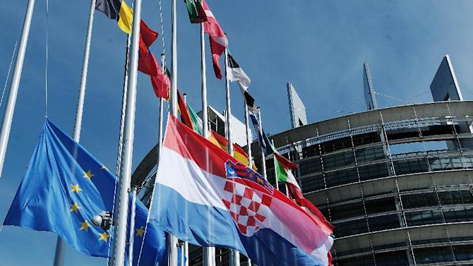 The Croatian flag is raised during a ceremony marking its accession to the European Union, July 1, 2013, at the European Parliament in Strasbourg, eastern France