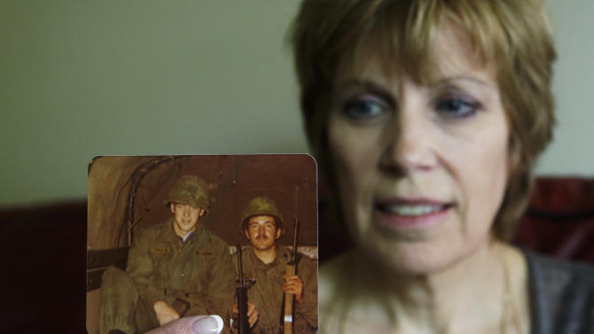 Connie Olberg holds a photo of her brother, Donald Douglass