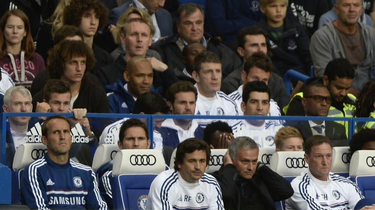 Chelsea's manager Jose Mourinho watches his team take on Fulham during their English Premier League soccer match in London
