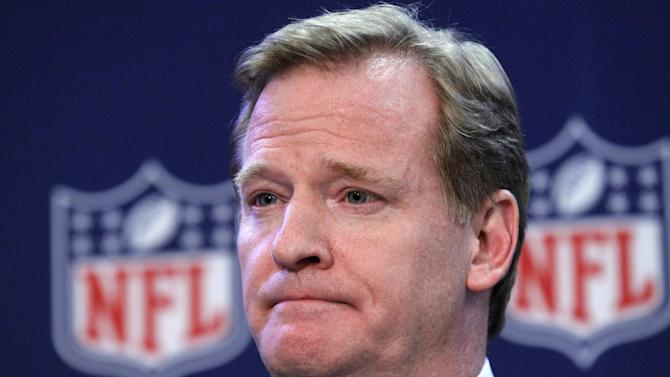 "NFL Commissioner Roger Goodell listens to a question during a news conference after the NFL owners meeting, Wednesday, Dec. 12, 2012, in Irving, Texas. Goodell said he ""fundamentally disagrees"" with former league boss Paul Tagliabue's decision not to discipline players in the New Orleans Saints bounty scandal. (AP Photo/LM Otero)"