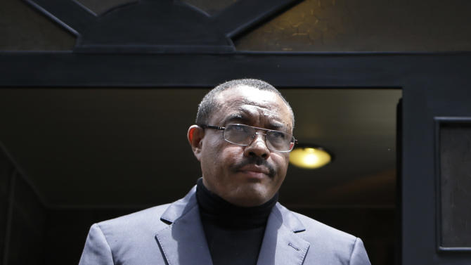 FILE - In this Friday, Aug. 24, 2012 file photo, then Acting Prime Minister Hailemariam Desalegn walks to pay his respects at the coffin of Prime Minister Meles Zenawi, after signing a condolences book at the national palace in Addis Ababa, Ethiopia. Ethiopia's parliament swore in new prime minister Hailemariam Desalegn Friday, Sept. 21, 2012 in the U.S. ally's first peaceful change of power in modern history, sparking hope for change in a nation that's largely a one-party state with a poor human rights record. (AP Photo/Rebecca Blackwell, File)