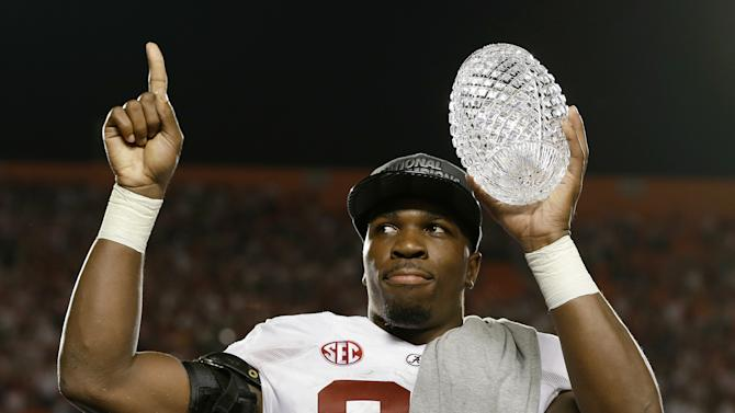 Alabama's C.J. Mosley holds up The Coaches' Trophy after the BCS National Championship college football game against Notre Dame Monday, Jan. 7, 2013, in Miami. Alabama won 42-14. (AP Photo/David J. Phillip)