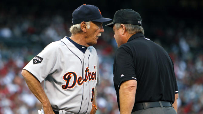 Detroit Tigers manager Jim Leyland, left, talks with first base umpire Joe West about a safe call on Los Angeles Angels' Howard Kendrick (not pictured) during the second inning of a baseball game in Anaheim, Calif., Tuesday, July 5, 2011. (AP Photo/Alex Gallardo)