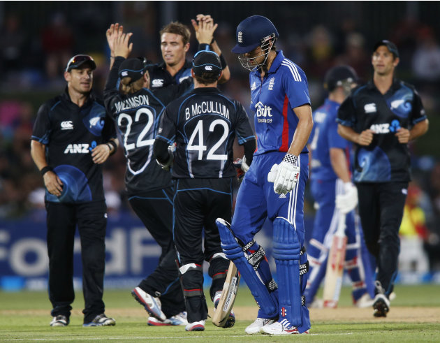 Southee of New Zealand celebrates with teammates after dismissing Cook of England during the second cricket match of their one-day international series in Napier