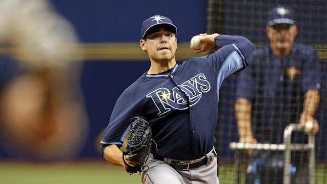 Tampa Bay Rays pitcher Matt Moore throws to batters for the first time since returning from Tommy John surgery prior to the team's baseball game against the Baltimore Orioles, Sunday, May 3, 2015, in St. Petersburg, Fla. The game was moved from Baltimore to St. Petersburg due to civil unrest. (AP Photo/Mike Carlson)