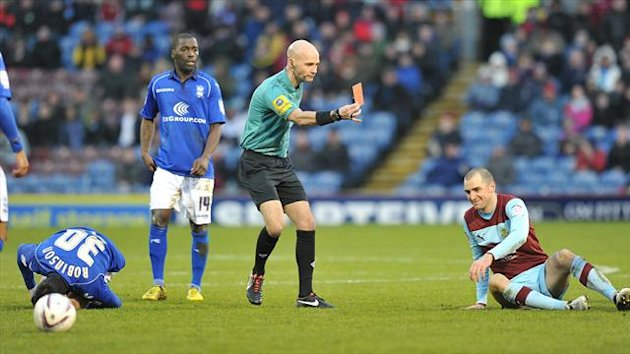 Dean Marney, right, was sent off against Birmingham for a tackle on Paul Robinson
