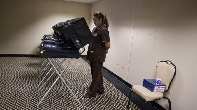 Liliana Perez, casts her ballot at an early voting polling place behind The Mirage Hotel Casino, Saturday, Oct. 20, 2012, in Las Vegas. President Barack Obama's immigration stance, and especially his executive order, has locked in support from a fast-growing demographic group that has been trending sharply Democratic in the wake of increasingly hardline Republican positions on immigration. The president's campaign is counting on Hispanics providing the margin of victory not just here in Nevada, but in other swing states like Colorado, Iowa, Virginia and North Carolina. (AP Photo/Julie Jacobson)